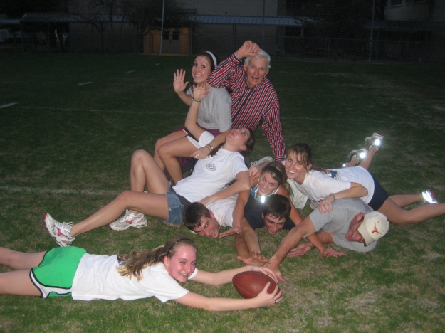 Dad playing football with all the grandkids