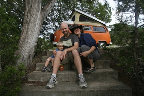"""Our family picture. Charlie, Turner and I camping with our VW Bus named Fillmore. We spend much of our free time camping, hiking and being outdoors. Our goal is to take Turner to all of the State Parks across Texas. We've taken him to 25. One day, we'd like to get Fillmore running in tip top shape, so we can drive up to Colorado for one of Turner's doctors appointments. It's the journey, not the destination that we look forward to."""