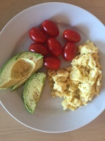 Breakfast: scrambled eggs, avocado & tomatoes -- all with some olive oil & salt & pepper