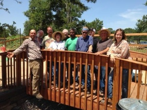 the garden crew on the bridge at Community First! Village