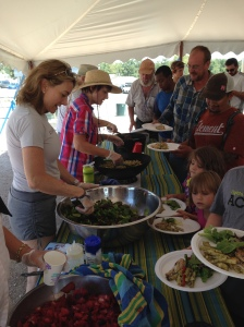 Serving lunch under the big tent at Community First! Village, everyone knows me by my big hat & plaid shirts